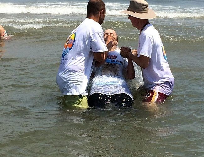 people being baptized in the ocean in ocean city md